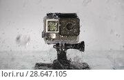 Купить «Action camera under rain», видеоролик № 28647105, снято 19 июня 2018 г. (c) Илья Шаматура / Фотобанк Лори