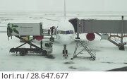 Купить «Service of the aircraft preparation for flight at a snowy aerodrome of Astana International Airport stock footage video», видеоролик № 28647677, снято 30 марта 2018 г. (c) Юлия Машкова / Фотобанк Лори