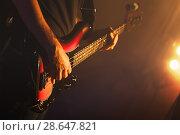 Купить «Guitarist plays on of bass guitar», фото № 28647821, снято 11 декабря 2016 г. (c) EugeneSergeev / Фотобанк Лори