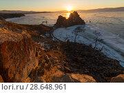 Купить «Olkhon island in early spring. Shaman rock and Baikal lake at sunset.», фото № 28648961, снято 16 июля 2018 г. (c) Владимир Пойлов / Фотобанк Лори