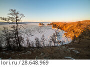 Купить «Olkhon island in early spring. Shaman rock and Baikal lake at sunset.», фото № 28648969, снято 3 июня 2020 г. (c) Владимир Пойлов / Фотобанк Лори