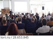 Купить «Business speaker giving a talk at business conference event.», фото № 28653845, снято 23 апреля 2015 г. (c) Matej Kastelic / Фотобанк Лори