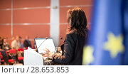Купить «Public speaker giving talk at Business Event.», фото № 28653853, снято 3 июля 2014 г. (c) Matej Kastelic / Фотобанк Лори