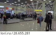 Купить «Inside the terminal of Sheremetyevo Airport, Moscow», видеоролик № 28655281, снято 30 октября 2017 г. (c) Данил Руденко / Фотобанк Лори