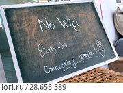 Купить «No Wi Fi sign. Sorry, but connecting people - chalk text written on blackboard at restaurant. Talk to each other concept», фото № 28655389, снято 4 мая 2018 г. (c) Alexander Tihonovs / Фотобанк Лори
