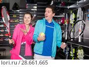 Купить «Girl and man in uniform choosing tennis rocket», фото № 28661665, снято 7 февраля 2018 г. (c) Яков Филимонов / Фотобанк Лори