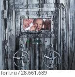 Купить «Portrait of a mad family behind a closed door», фото № 28661689, снято 3 августа 2017 г. (c) Яков Филимонов / Фотобанк Лори