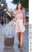 Купить «Young traveling woman going to the historic city center», фото № 28661805, снято 26 августа 2017 г. (c) Яков Филимонов / Фотобанк Лори