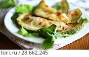 Купить «Fried zucchini seasoned with dill», видеоролик № 28662245, снято 30 июня 2018 г. (c) Peredniankina / Фотобанк Лори