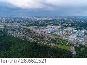 Купить «Aerial view of wheat fields, meadow, forest andindustrial warehouses in rural Russia.», фото № 28662521, снято 11 июня 2018 г. (c) Андрей Радченко / Фотобанк Лори