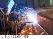 Купить «industrial arc welding work», фото № 28664189, снято 28 ноября 2017 г. (c) Дмитрий Калиновский / Фотобанк Лори