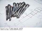 Купить «Engineering and metalworking industry. Metal details on print drawing», фото № 28664237, снято 1 марта 2016 г. (c) Дмитрий Калиновский / Фотобанк Лори