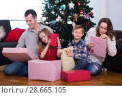 Купить «Happy family members presenting gifts on Christmas», фото № 28665105, снято 25 апреля 2019 г. (c) Яков Филимонов / Фотобанк Лори