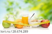 Купить «breakfast food and measuring tape on table», фото № 28674289, снято 12 января 2013 г. (c) Syda Productions / Фотобанк Лори