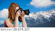 Купить «woman with backpack and camera over alps mountains», фото № 28674321, снято 25 июля 2015 г. (c) Syda Productions / Фотобанк Лори