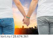 Купить «male couple with gay pride rainbow wristbands», фото № 28674361, снято 2 ноября 2017 г. (c) Syda Productions / Фотобанк Лори