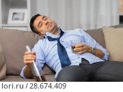 Купить «drunk man with bottle of alcohol sleeping at home», фото № 28674409, снято 24 ноября 2017 г. (c) Syda Productions / Фотобанк Лори