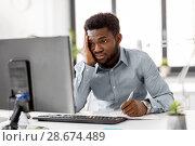 Купить «businessman with computer and papers at office», фото № 28674489, снято 7 апреля 2018 г. (c) Syda Productions / Фотобанк Лори