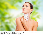 Купить «woman with orchid flower over green background», фото № 28674597, снято 25 июля 2013 г. (c) Syda Productions / Фотобанк Лори