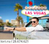 Купить «happy man driving convertible car at las vegas», фото № 28674621, снято 15 июля 2015 г. (c) Syda Productions / Фотобанк Лори