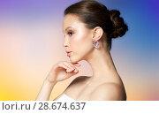 Купить «close up of beautiful woman face with earring», фото № 28674637, снято 9 апреля 2016 г. (c) Syda Productions / Фотобанк Лори