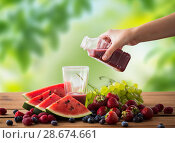 Купить «hand pouring fruit juice from bottle to glass», фото № 28674661, снято 5 августа 2016 г. (c) Syda Productions / Фотобанк Лори