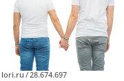 Купить «male couple with gay pride rainbow wristbands», фото № 28674697, снято 2 ноября 2017 г. (c) Syda Productions / Фотобанк Лори