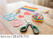 Купить «scissors and gay party props on wooden table», фото № 28674713, снято 14 ноября 2017 г. (c) Syda Productions / Фотобанк Лори