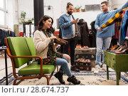 Купить «friends choosing clothes at vintage clothing store», фото № 28674737, снято 30 ноября 2017 г. (c) Syda Productions / Фотобанк Лори