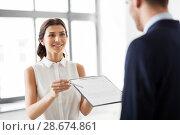 Купить «realtor showing contract document to customer», фото № 28674861, снято 8 июня 2018 г. (c) Syda Productions / Фотобанк Лори