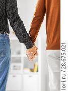 Купить «close up of male gay couple holding hands», фото № 28675021, снято 2 ноября 2017 г. (c) Syda Productions / Фотобанк Лори