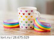 Купить «cup with heart pattern and gay awareness ribbon», фото № 28675029, снято 14 ноября 2017 г. (c) Syda Productions / Фотобанк Лори