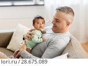 Купить «happy father with little baby boy at home», фото № 28675089, снято 14 апреля 2018 г. (c) Syda Productions / Фотобанк Лори