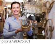Купить «Portrait of smiling female holding glass item in store», фото № 28675961, снято 22 ноября 2017 г. (c) Яков Филимонов / Фотобанк Лори