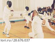 Купить «Mixed age group of athletes at fencing workout», фото № 28676037, снято 30 мая 2018 г. (c) Яков Филимонов / Фотобанк Лори