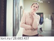 Купить «Woman standing in art museum», фото № 28683437, снято 18 ноября 2017 г. (c) Яков Филимонов / Фотобанк Лори