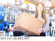 Купить «Portrait of pretty young woman with box», фото № 28683497, снято 12 декабря 2017 г. (c) Яков Филимонов / Фотобанк Лори