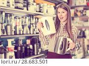 Купить «delighted young woman with purchase», фото № 28683501, снято 12 декабря 2017 г. (c) Яков Филимонов / Фотобанк Лори