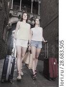 Купить «female tourists exploring old european city with baggage», фото № 28683505, снято 29 мая 2017 г. (c) Яков Филимонов / Фотобанк Лори