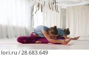Купить «woman doing yoga exercise at studio», видеоролик № 28683649, снято 28 июня 2018 г. (c) Syda Productions / Фотобанк Лори