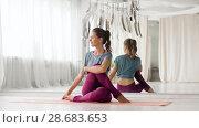 Купить «woman doing yoga exercise at studio», видеоролик № 28683653, снято 28 июня 2018 г. (c) Syda Productions / Фотобанк Лори