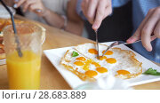 Купить «Male hands cuts a tasty and useful fried eggs with a knife and fork in restaurant», видеоролик № 28683889, снято 17 июля 2018 г. (c) Константин Шишкин / Фотобанк Лори
