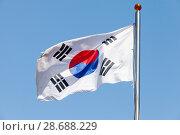 Купить «Flag of South Korea over blue sky», фото № 28688229, снято 17 марта 2018 г. (c) EugeneSergeev / Фотобанк Лори