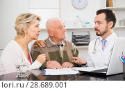 Купить «Old father with daughter visit doctor», фото № 28689001, снято 10 декабря 2019 г. (c) Яков Филимонов / Фотобанк Лори