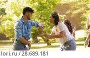 Купить «happy friends dancing at summer party in park», видеоролик № 28689181, снято 26 июня 2018 г. (c) Syda Productions / Фотобанк Лори