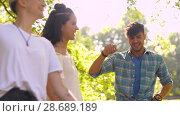 Купить «happy friends dancing at summer party in park», видеоролик № 28689189, снято 26 июня 2018 г. (c) Syda Productions / Фотобанк Лори