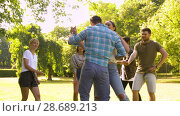 Купить «happy friends dancing at summer party in park», видеоролик № 28689213, снято 26 июня 2018 г. (c) Syda Productions / Фотобанк Лори