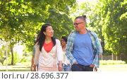Купить «happy international friends walking in park», видеоролик № 28696377, снято 25 июня 2018 г. (c) Syda Productions / Фотобанк Лори