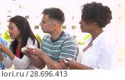 Купить «friends eating sandwiches or burgers in park», видеоролик № 28696413, снято 25 июня 2018 г. (c) Syda Productions / Фотобанк Лори