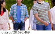 Купить «happy international friends walking in summer park», видеоролик № 28696469, снято 25 июня 2018 г. (c) Syda Productions / Фотобанк Лори